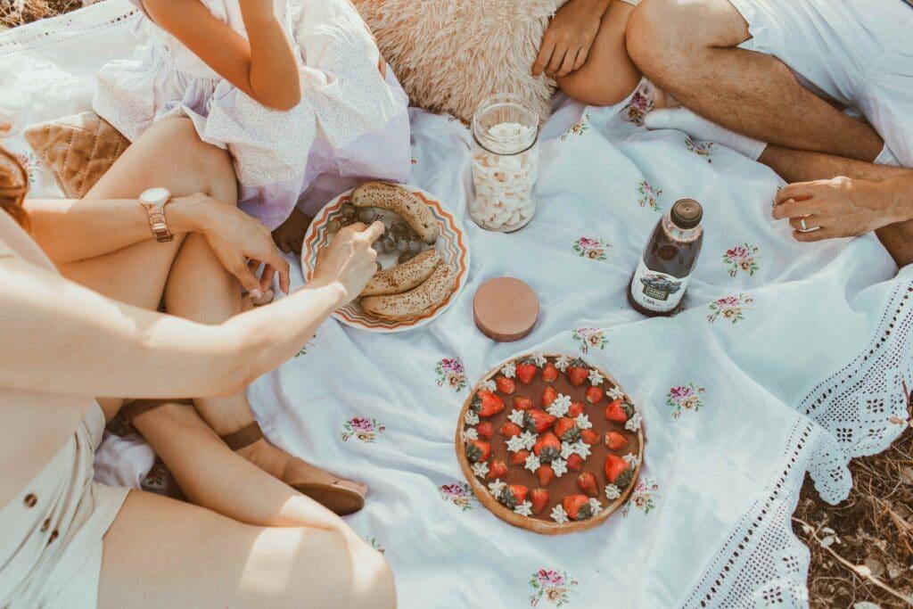people eating food at picnic